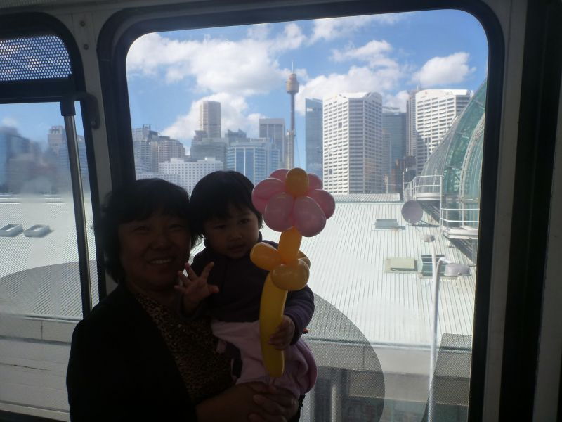 Pictured are my daughter and my mother-in-law on their first trip on monorail and potentially their last.  Picture taken with city background so my mother-in-law can share this memory with her family in Shanghai, China.